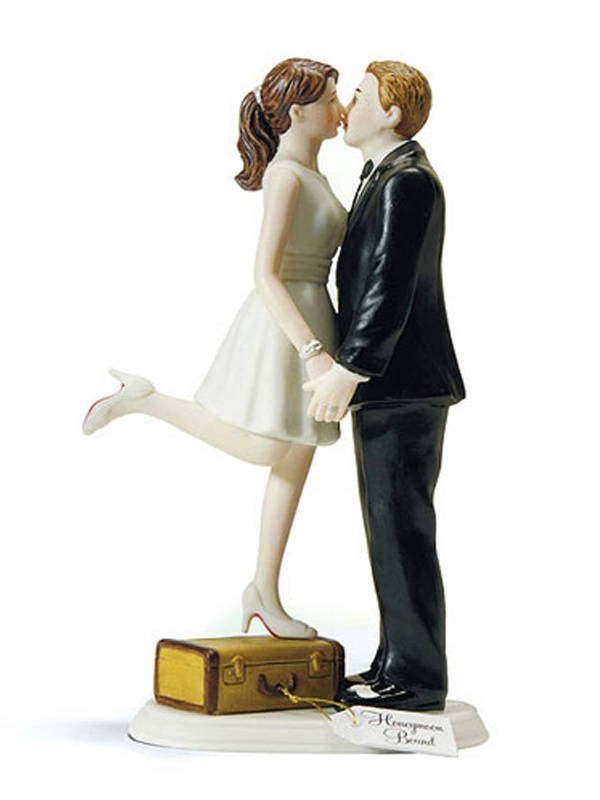 A Kiss and We're Off Bride and Groom Wedding Cake Top