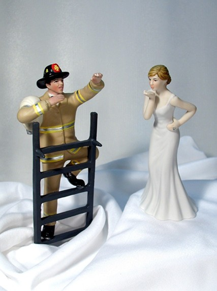 Climbing Firefighter Groom Tan Gear and Bride Blowing Kisses